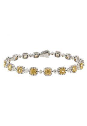 Fancy Yellow Diamond Tennis Bracelet with Halos of White Diamonds in 18k White Gold